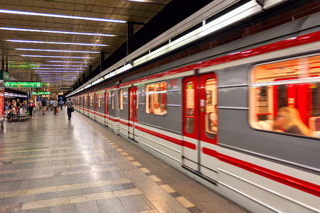 kilometres: PRAGUE CZECH REPUBLIC  JULY 16 2009: Train leaves metro station  rapid transit network of Prague founded in 1974 contains 3 lines 57 stations is 59.4 kilometres long which makes it fifth busiest metro system in Europe.