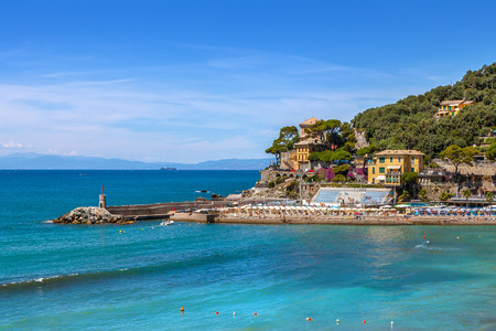 Small pier and view of Mediterranean sea from town of Recco in Liguria Italy.