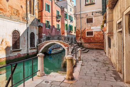 venice bridge: Small canal among old typical venetian houses and small bridge in Venice, Italy.