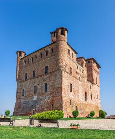 piedmont: Medieval castle under blue sky in Piedmont, Northern Italy.