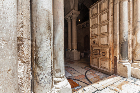 sepulchre: Marble pillars and old wooden door at the entrance to the Church of the Holy Sepulchre in Jerusalem, Israel. Stock Photo