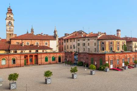 town houses: Bell tower among old houses in small town of racconigi in Piedmont, Italy.