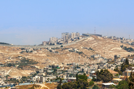 seperation: Palestinian village and town on the hill behind separation wall on the West Bank in Israel.