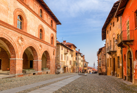 saluzzo: Colorful houses and cobbled street in old town of Saluzzo in Piedmont, Northern Italy.