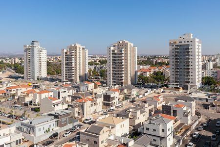 Contemporary residential buildings and houses in new neighborhood of Kiryat Gat - city in southern district of Israel. Stock Photo