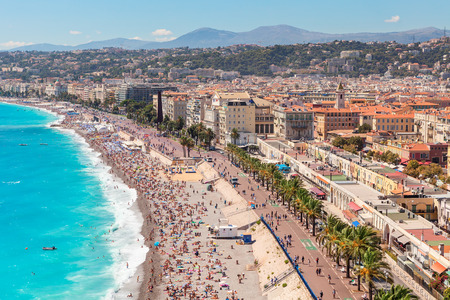 promenade: NICE, FRANCE - AUGUST 23, 2014: Beach and promenade Anglais in Nice - fifth most populous, second-largest on French Mediterranean coast and one of most visited cities with 4 million tourists every year.