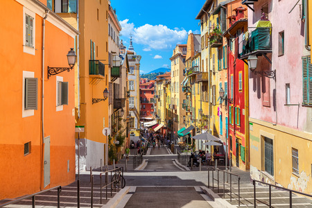 NICE, FRANCE - AUGUST 23, 2014: Narrow street in old tourist part of Nice - fifth most populous city and one of the most visited cities in France, receiving 4 million tourists every year. 에디토리얼