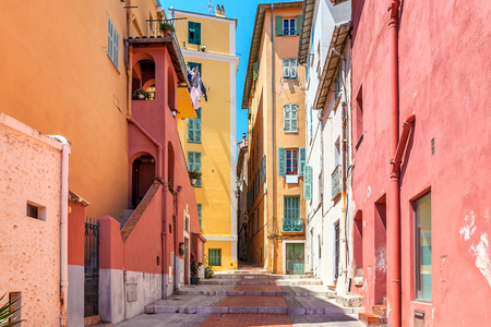menton: Narrow street among old colorful houses in Menton, France.