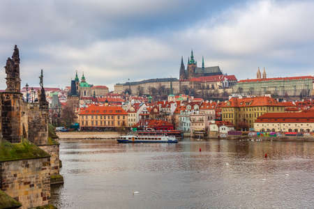 vitus: View of Vltava River, Old Town and St. Vitus Cathedral on background in Prague, Czech Republic. Stock Photo