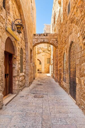 stoned: Narrow street among typical stoned houses of jewish quarter in Old City of Jerusalem, Israel.