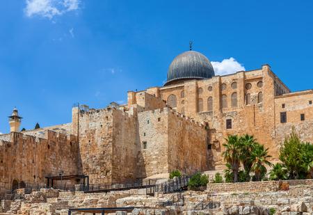 al aqsa: Ancient walls and Al Aqsa Mosque dome under blue sky in Old City of Jerusalem, Israel. Stock Photo