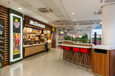 PRAGUE, CZECH REPUBLIC - SEPTEMBER 23, 2015: McDonalds restaurant inside of Flora commercial center. McDonalds, founded in 1940, is worlds largest chain of fast food serving millions of customers daily in 119 countries.