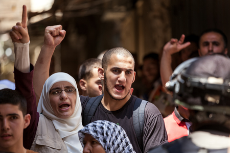 middle east crisis: JERUSALEM, ISRAEL - JULY 26, 2015: Palestinians in Old City of Jerusalem protest against ascent of religious jews to Temple Mount during Tisha BAv - annual fast day in Judaism commemorates destruction of  First and Second Temples. Editorial