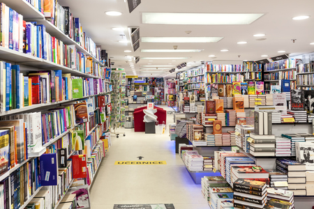 the throughout: PRAGUE, CZECH REPUBLIC - SEPTEMBER 23, 2015: Interior view of Dobrovsky bookstore located on Wenceslas Square in Prague. This is one of the largest and famous networks specializing in books sales with 24 stores throughout the contry.