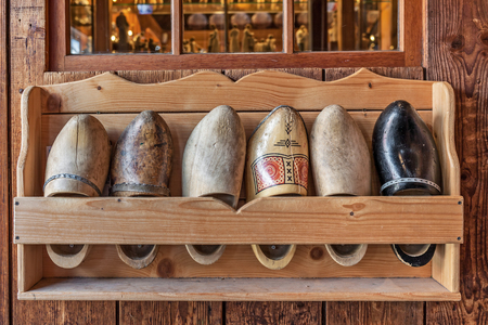 dutch typical: Typical wooden dutch clogs on the stand in Zaanse Schans, Netherlands.