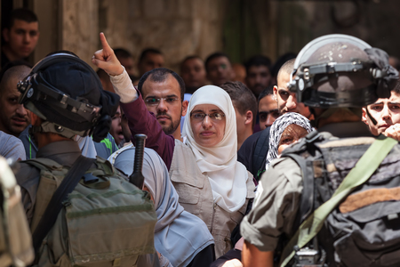 middle east crisis: JERUSALEM, ISRAEL - JULY 26, 2015: Palestinian protest in Old City of Jerusalem against ascent of jews to Temple Mount during Tisha BAv - annual fast day in Judaism commemorates destruction of  First and Second Temples.