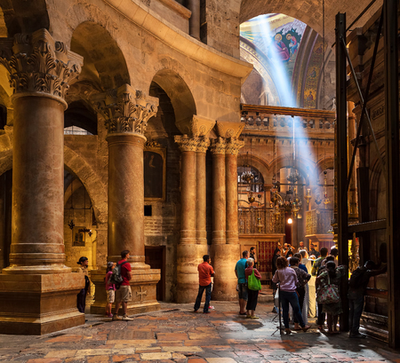 sepulchre: JERUSALEM, ISRAEL - JULY 26, 2015: People inside the Church of the Holy Sepulchre - holy place where according christian tradition Jesus was crucified, buried and resurrected. Editorial