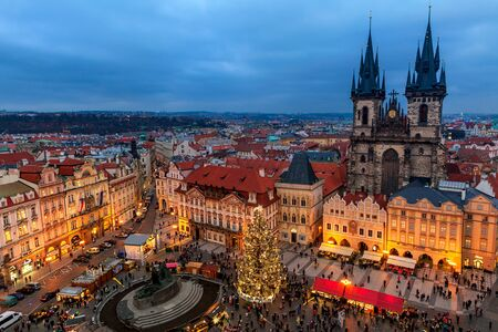 PRAGUE, CZECH REPUBLIC - DECEMBER 10, 2015: View from above on Tyn church, Christmas tree and traditional market in Old Town of Prague - famous and popular destionation with locals and tourists during winter holidays.