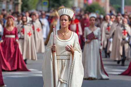parades: ALBA, ITALY - OCTOBER 05, 2014: Participant in historic dress on Medieval Parade. Parade is traditional part of celebrations during annual White Truffel festival taking place each year on October in Alba, Italy.