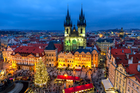 europeans: PRAGUE, CZECH REPUBLIC - DECEMBER 10, 2015: View from above on traditional market at Old Town Square illuminated and decorated for Christmas holidays in Prague  -  popular tourist destination, capital of Czech Republic and fifth most visited European city