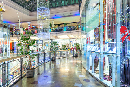 palladium: PRAGUE, CZECH REPUBLIC - DECEMBER 10, 2015: Interior of Palladium mall decorated for Christmas holidays - one of the biggest shopping centers in Prague, popular destination with locals and tourists, contains 5 floors, 184 shops and 23 restaurants.