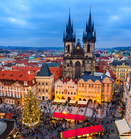 PRAGUE, CZECH REPUBLIC - DECEMBER 10, 2015: View from above on Tyn church, Christmas tree and traditional market on Old Town Square of Prague - famous and popular destionation with locals and tourists during winter holidays.