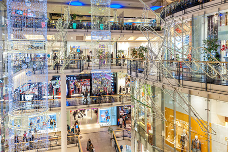 centers: PRAGUE, CZECH REPUBLIC - DECEMBER 10, 2015: Interior view of Palladium mall decorated for Christmas holidays - one of the biggest shopping centers in Prague, popular destination with locals and tourists, contains 5 floors, 184 shops and 23 restaurants.
