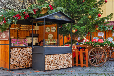 each year: PRAGUE, CZECH REPUBLIC - DECEMBER 10, 2015: Wooden stalls offering traditional sweetes and wine during Christmas market taking place each year on December in Old Town of Prague.