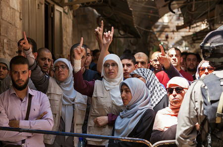 middle east conflict: JERUSALEM, ISRAEL - JULY 26, 2015: Palestinians protest in Old City of Jerusalem against ascent of religious jews to Temple Mount during Tisha BAv - annual fast day in Judaism commemorates destruction of  First and Second Temples. Editorial