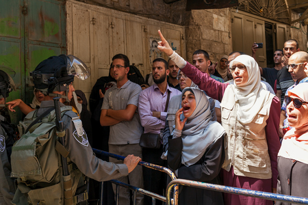 palestinian: JERUSALEM, ISRAEL - JULY 26, 2015: Palestinians in Old City of Jerusalem protest against ascent of jews to Temple Mount during Tisha BAv - annual fast day in Judaism commemorates destruction of  First and Second Temples. Editorial