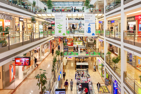 PRAGUE, CZECH REPUBLIC - SEPTEMBER 23, 2015: Palac Flora shopping center interior. Opened in 2003, contains 4 floors, 120 shops, Cinema City & theater and is one of the largest malls in Prague.