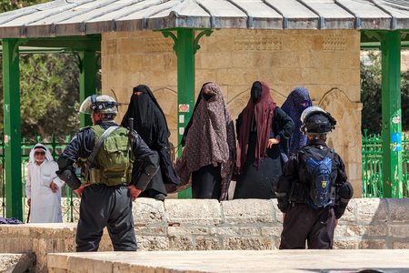 JERUSALEM, ISRAEL - JULY 26, 2015: Group of palestinian women in niqab protest in Old City of Jerusalem against ascent of jews to Temple Mount during Tisha B'Av - annual fast day in Judaism commemorates destruction of  First and Second Temples.