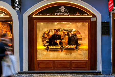 decorated: PRAGUE, CZECH REPUBLIC - DECEMBER 10, 2015: Frozen glass of Captain Candy  window - famous exclusive candy shop in Old Town. It is popular place with tourists visiting Prague.