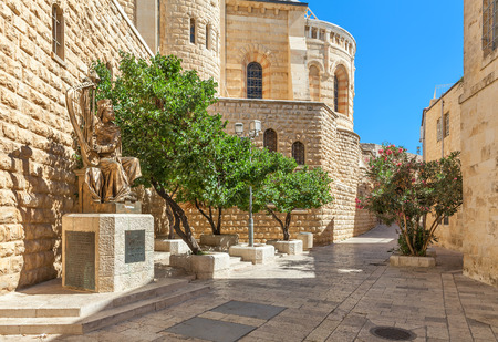 believed: JERUSALEM, ISRAEL - JULY 16, 2015: Sculpture of King David playing harp near entrance to his tomb on Mount Zion. This is also the place believed by Christians of the Last Supper of Jesus.
