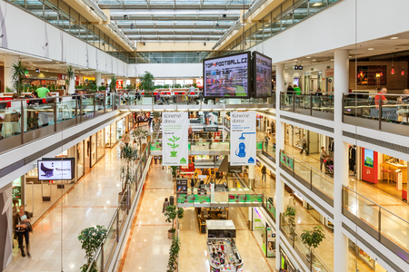 shopping mall interior: PRAGUE, CZECH REPUBLIC - SEPTEMBER 23, 2015: Palac Flora shopping mall interior. Opened in 2003, contains 4 floors, 120 shops, Cinema City & IMAX theater and is one of the largest malls in Prague.