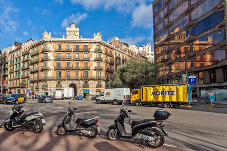 BARCELONA, SPAIN - JANUARY 13, 2015: Typical urban city center view of Barcelona - capital city of Catalonia, second most populated in Spain, one of the worlds leading tourist, economic, and cultural centers.