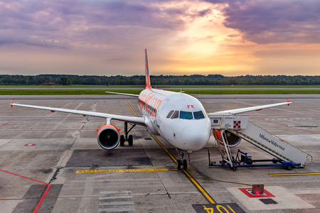 runways: MALPENSA, ITALY - SEPTEMBER 22, 2015: Easyjet airplane on parking in Milan Malpensa airport -  largest airport for the Milan metropolitan area, serves 15 million inhabitants, has two terminals and two runways. Editorial