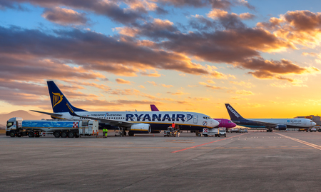 BERGAMO, ITALY - JANUARY 13, 2015: Ryanair airplane on the parking under beautiful morning sky at Orio al Serio International Airport. Ryanair is an Irish airline and worlds leader low-cost airline company. Editorial