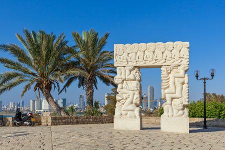 yafo: Statue of Faith as Tel Aviv on background under blue sky in Old Jaffa, Israel.