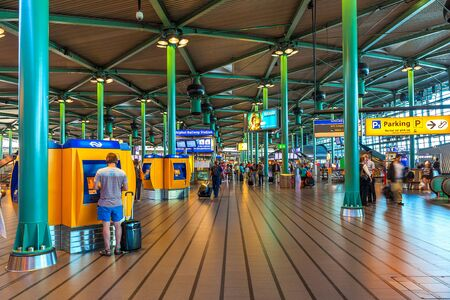 AMSTERDAM, NETHERLANDS - JULY 07, 2015: Entrance hall in Schiphol airport - opened on 16 September 1916 as military airbase now it is main international airport of the Netherlands and fifth busiest in Europe.