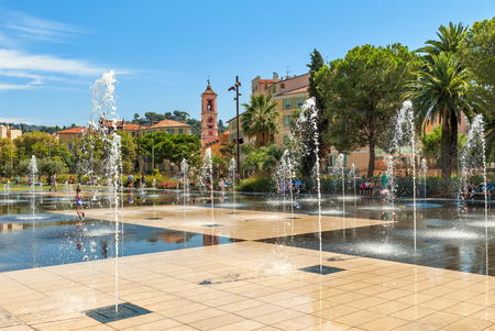NICE, FRANCE - SEPTEMBER 02, 2015: People among fountains at Promenade du Paillon - 12 hectares, 1.2km long new green pedestrian walkway area in the heart of Nice opened on October 26, 2013. Editorial