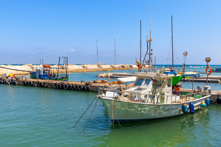 yaffo: Small fishing boat in port of Jaffa, Israel.