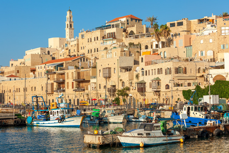 yaffo: Boats on small harbor and old houses in Jaffa, Israel. Stock Photo