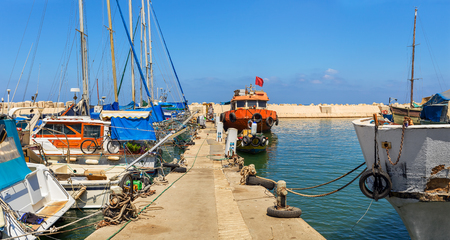 yaffo: Fishing boats in old port of Jaffa, Israel (panorama).