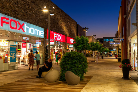 ashdod: ASHDOD, ISRAEL - JULY 03, 2016: Shops and boutiques in openair mall at evening - owned by BIG Shopping Centers Ltd., founded in 1994 and operates in four countries.