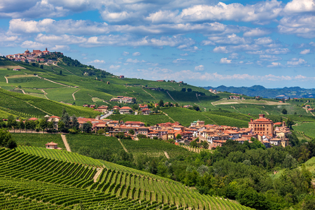 Small town of Barolo among hills and green vineyards in Piedmont, Northern Italy.