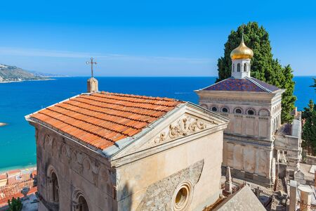 menton: Tomb and small orthodox church on old cemetery of Menton with view on Mediterranean sea on French Riviera.