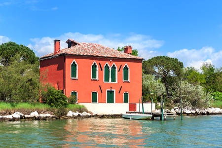 View of two story house on one of small island in Venetian Lagoon in Italy.