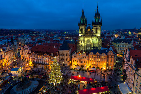 PRAGUE, CZECH REPUBLIC - DECEMBER 10, 2015: Evening view from above of traditional Christmas market at Old Town Square in Prague - popular tourist destination, fifth most visited European city.