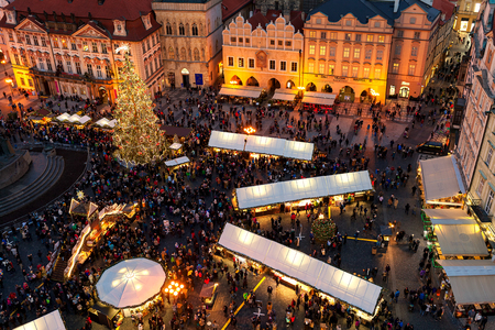 PRAGUE, CZECH REPUBLIC - DECEMBER 11, 2016: View from above on famous traditional Christmas market at Old Town Square illuminated and decorated for xmas holidays in Prague - capital of Czech Republic.